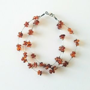 Amber Layered Strand Floating Bead Silver Bracelet